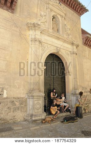 GRANADA, SPAIN - MAY 20, 2017: Street musicians in front of a church on the road
