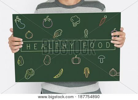 People holding a board about healthy nutrition Veggie