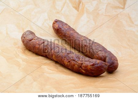 Delicious high quality smoked sausage on a crumpled paper