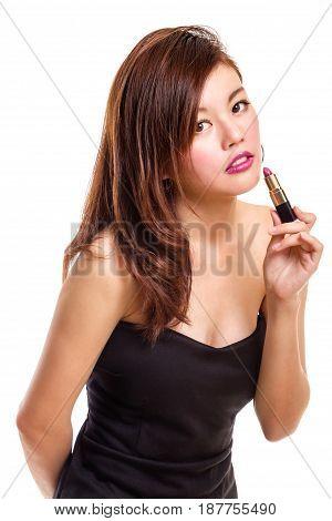 Attractive Asian Woman Applying Lipstick