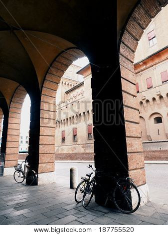Castle of Ferrara, Italy. Seen from the theater arcades. With bicycles.