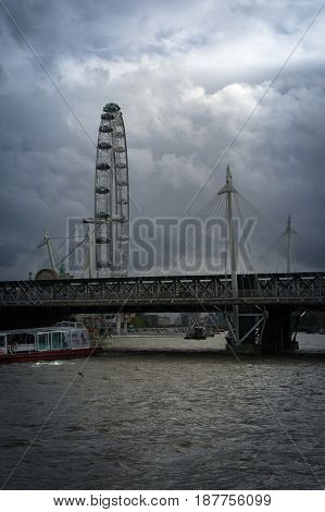 view of the london eye from river thames