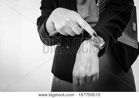 Business Woman Pointing to His Watch Isolated on a White Background