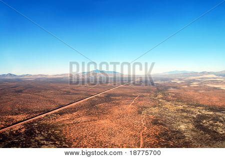 Aerial of the U.S. Mexico border fence in the Arizona desert poster