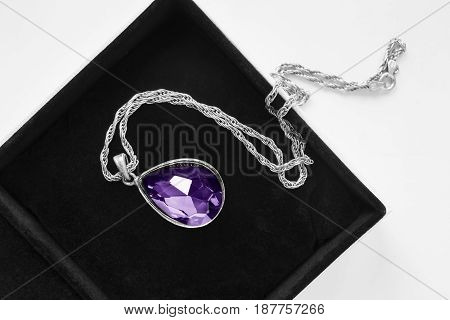 Large amethyst pendant on silver chain in jewel box