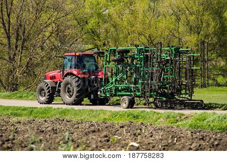 Tractor With Cultivator On The Rural Road
