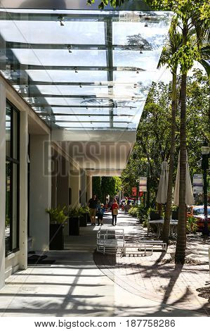 Sarasota, FL, USA - 06/29/2016: Sidewalk glass canopy outside a restaurant in downtown Sarasota FL