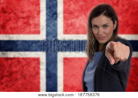 Beautiful Businesswoman Pointing Her Finger At You Norwegian Flag Background.