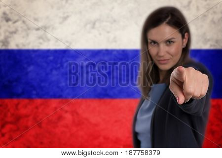 Beautiful Businesswoman Pointing Her Finger At You Russian Flag Background.