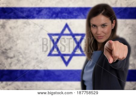 Beautiful Businesswoman Pointing Her Finger At You Israel Flag Background.