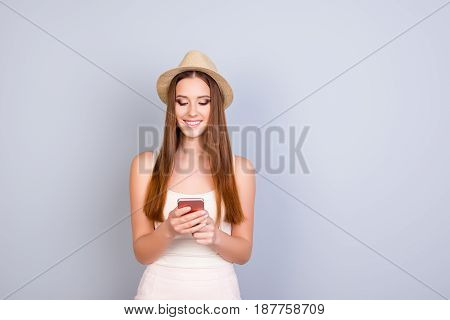 Roaming And Communication Concept. Young Cute Blond Tourist In A Hat Is Typing On Her Pda At The Vac