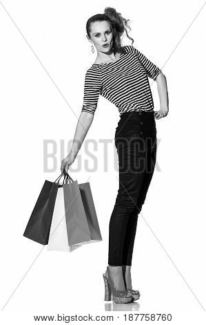 Cheerful Trendy Woman With Shopping Bags On White Background