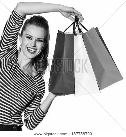 Happy Fashion-monger Showing Shopping Bags On White Background
