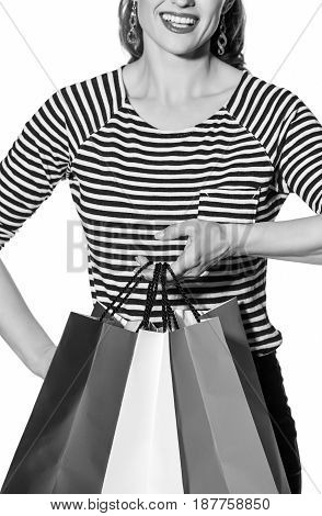 Shopping. The French way. Closeup on happy stylish fashion-monger with shopping bags of the colours of the French flag isolated on white background