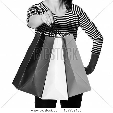 Closeup On Trendy Woman On White Giving Shopping Bags