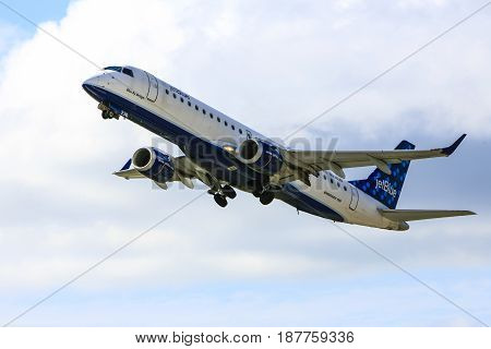 Sarasota, FL, USA - 01/06/2017: Embraer ERJ-190AR commercial jet passenger plane of Jet Blue Airways leaves Sarasota airport for JFK New York