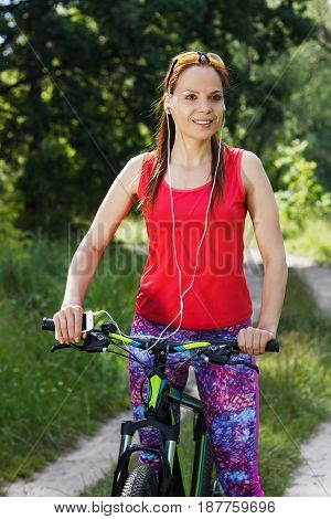 Sports Woman With A Sport Bicycle Listening Music