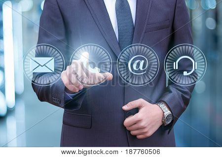 Businessman Pressing Phone Button.