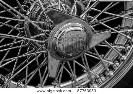 Close detail view of a wire wheel on a classic British motor car