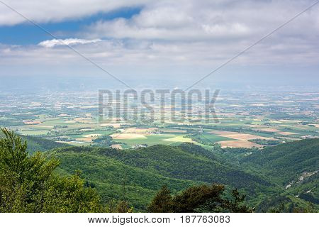 French countryside. View over the Rhone Valley with its fields and the Ardeche in the background.
