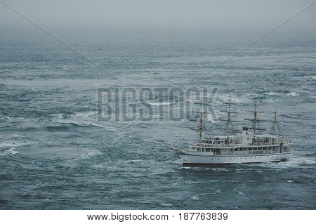 A ship that crosses the sea through a maelstrom. Japan, the whirlpools of Naruto