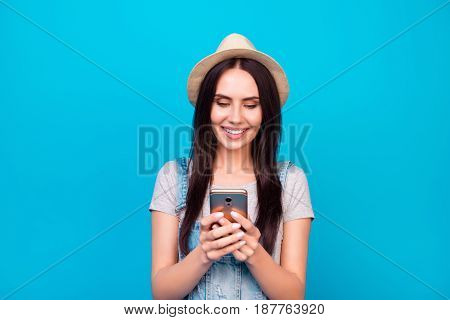 Roaming Concept. Young Cute Brunette Tourist In A Hat Is Typing On Her Pda At The Vacation. She Is I