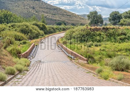 Paved road at the entrance to Nieu-Betesda an historic village in the Eastern Cape Province