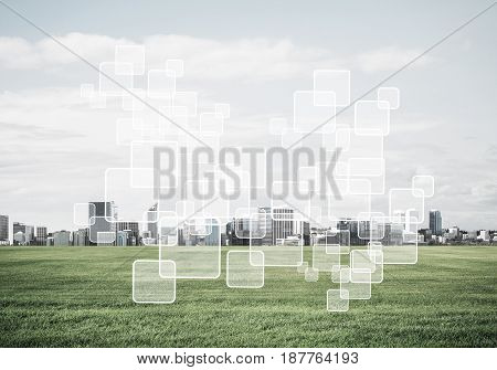 Concept of modern technologies with media icons on screen and business city at background
