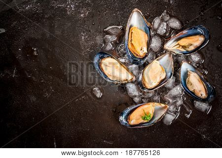 Prepared For Cooking Dinner Seafood - Fresh Opened Mussels On Ice, On Black Concrete Table, With Lem