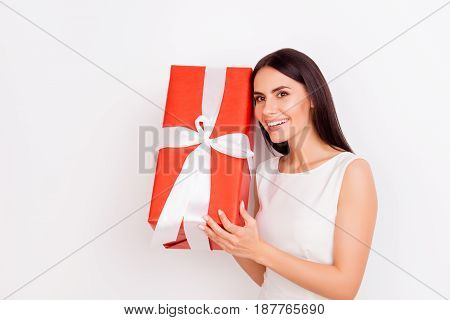 Great Surprise! Excited Cute Brunette Lady Is Holding Present And Wondering What Is Inside On White