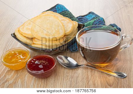 Pancakes In Bowl, Jam, Transparent Cup Of Tea And Spoon