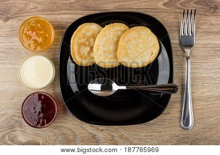 Black Plate With Pancakes And Spoon, Bowls With Jam