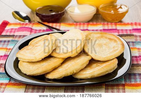 Black Plate With Heap Of Pancakes On Napkin