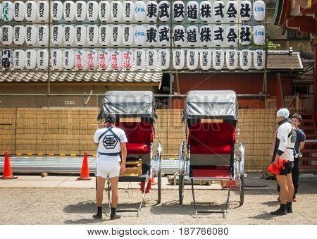 Tokyo Japan - May 4 2017: Japanese man in traditional clothes pulling a rickshaw cart