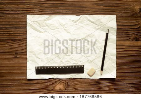 Blank paper page pencil and ruler on wooden desk table.