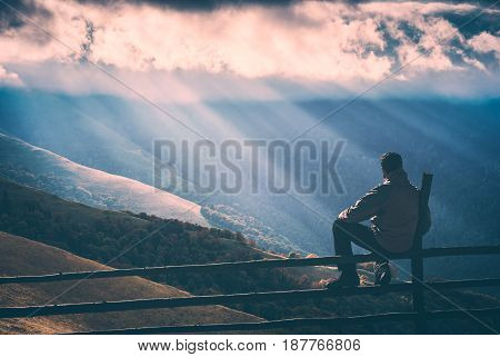 Hiker Sitting On A Wooden Fence. Instagram Stylisation