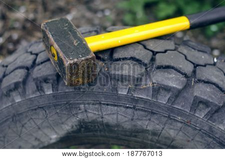Hammer and tyre. Cross fit exercise concept.