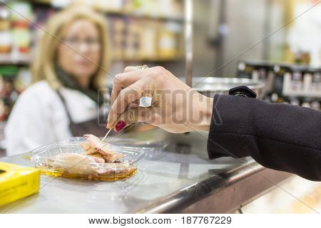 Female Hand Takes Seafood on Eat Market