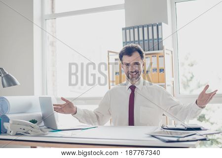 Successful Businessman Is Welcoming People In His Modern Nice Office. He Is Wearing White Shirt And