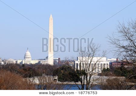 Skyline of Washington DC in winter, including the Capitol, the Washington Monument, and the Lincoln Memorial, as seen from Arlington, Virginia, across the Potomac River.