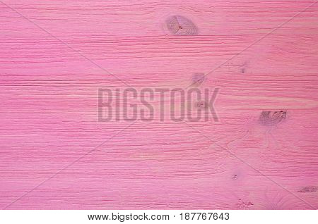 Magenta wooden background texture. Magenta desk table.