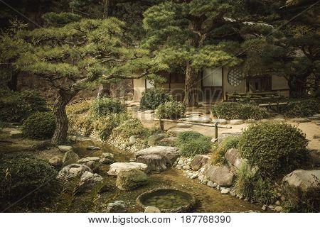 Japanese garden at sunset in Ritsurin Park, Takamatsu, Japan