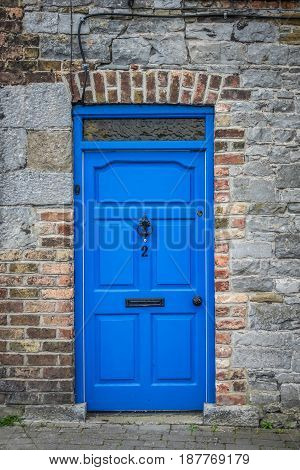 Typical blue front door in an old home in Limerick, Ireland