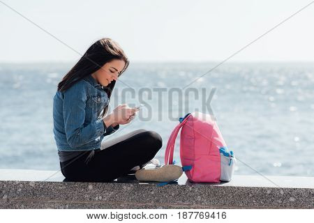 Beautiful Tourist Girl Looking Into Your Phone