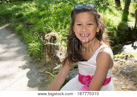 Young 10 Year Old Girl Sitting In A Park