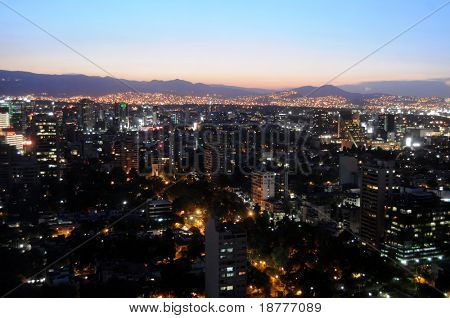 Skyline of Mexico City just after sunset, shot from Colonio Polanco district towards northwest. The sky is unusually clear and free of smog.