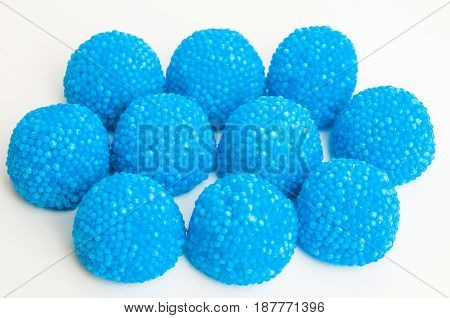 Gummy blue Raspberries. Delicious treats on white background