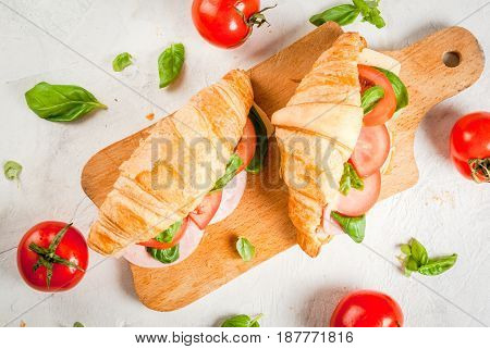 Croissant With Ham, Cheese, Fresh Tomatoes And Basil