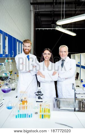 It`s A Breakthrough! Successful Group Of Three Scientists Are Smiling, They Finished An Experiment I