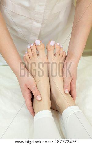 Procedure of foot massage girls in the beauty salon